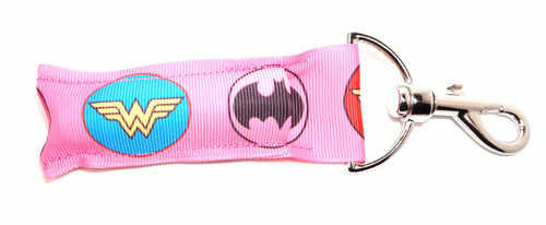 Superhero Lip balm Holder pink with circle logo's     This lip balms holder is very durable with a stainless steel hook that is easily attached and unattached to a purse, keys, backpack, or lanyard. This lip balm holder has multiple Superhero logo's .   Superhero logos on this holder:  Spiderwoman  Superwoman  Wonder Woman  Batgirl  MADE IN THE USA!!