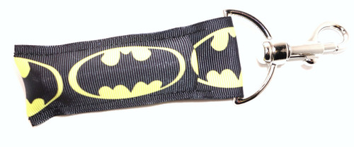 Lip Balm Holder Batman   Each Lip Balm / Chapstick Holder is HANDMADE with a high-quality material! Our unique design's and clasp offer both style and functionality. The hook is also on a swivel head so the lip balm always falls back down and never gets stuck upside down, this is where most lip balm holders lose your lip balm or chapstick! The holder is designed to snuggly fit any standard chapstick or lip balm. This ensures that the lip balm / chapstick won't fall out when needed most.   BENEFITS: Misplacing or Losing your lip balm or chapstick is the worst!! Don't let that happen again and buy the perfect solution! Our Lip Balm / Chapstick Holder Keychain will make sure you always have your Gettin Lippy lip balm at hand when desperately needed. Our cute fun designs will compliment anything. Attach it to your keys, lanyard, back-pack, bag, purse, or anywhere your little heart desires with our easy open clasp!   PERFECT GIFTS: A simple gift can go a long way. Everyone needs something cute and functional. Buy now for stocking stuffers, birthday party, a team gift or for a daughter, friend, wife, girlfriend, colleague, student, teacher, etc!   BUY WITH CONFIDENCE: Read the reviews! Our Gettin Lippy Lip balm holders are the number one rated lip balm holders on the market! If you don't LOVE our product, we offer 100% Money Back GUARANTEE no questions asked.   PACKAGE INCLUDES:  1 Unique Lip Balm / Chapstick holder. Each Holder is 6.5 inches (with hook) x 1.5 inches. **NOTE: Gettin Lippy lip balms in pictures are not included but click on the link below and get the best multi-flavored lip balm on the market: https://gettinlippy.com/gettin-lippyoriginal-line/     HANDMADE IN THE USA!!