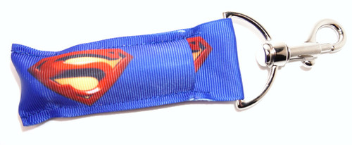 Superman Lip Balm Holder   This lip balms holder is very durable with a stainless steel hook that is easily attached and unattached to a purse, keys, backpack, or lanyard. This lip balm holder has multiple Superhero logo's .  Superhero logo's on this holder:  Superman  MADE IN THE USA!!