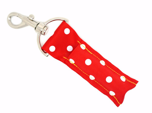 Red with Small White Dots       This lip balms holder is very durable with a stainless steel hook that is easily attached and unattached to a purse, keys, backpack, or lanyard.  MADE IN THE USA!