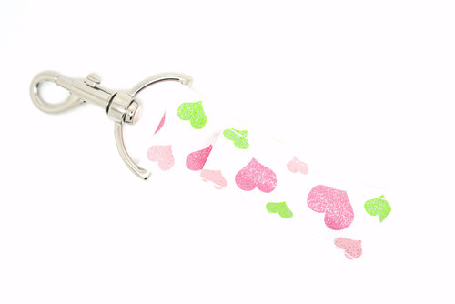 Hearts white Lip balm Holder with pink and green hearts with glitter  This lip balms holder is very durable with a stainless steel hook that is easily attached and unattached to a purse, keys, backpack, or lanyard. This lip balm holder has a white background with pink and green hearts with glitter.   MADE IN THE USA!!
