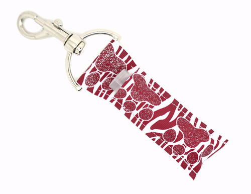 Maroon and glitter Paw prints on top of maroon and white zebra print Lip Balm Holder   This lip balms holder is very durable with a stainless steel hook that is easily attached and unattached to a purse, keys, backpack, or lanyard. This lip balm holder has a maroon with glitter paw prints on top of maroon and white zebra print!  MADE IN THE USA!!