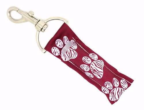 Lip Balm Holder Maroon with White Zebra Paw Prints   Each Lip Balm / Chapstick Holder is HANDMADE with a high-quality material! Our unique design's and clasp offer both style and functionality. The hook is also on a swivel head so the lip balm always falls back down and never gets stuck upside down, this is where most lip balm holders lose your lip balm or chapstick! The holder is designed to snuggly fit nice and cozy any standard chapstick or lip balm. This ensures that the lip balm / chapstick won't fall out when needed most.   BENEFITS: Misplacing or Losing your chapstick is the worst!! Don't let that happen again and buy the perfect solution! Our Lip Balm / Chapstick Holder Keychain will make sure you always have your Gettin Lippy lip balm at hand when desperately needed. Our cute fun designs will compliment anything. Attach it to your keys, lanyard, back-pack, bag, purse, or anywhere your little heart desires with our easy open clasp!   PERFECT GIFTS: A simple gift can go a long way. Everyone needs something cute and functional. Buy now for stocking stuffers, birthday party, a team gift or for a daughter, friend, wife, girlfriend, colleague, student, teacher, etc!     BUY WITH CONFIDENCE: Read the reviews! Our Gettin Lippy Lip balm holders are the number one rated lip balm holders on the market! If you don't LOVE our product, we offer 100% Money Back GUARANTEE no questions asked.   PACKAGE INCLUDES:  1 Unique Lip Balm / Chapstick holder. Each Holder is 6.5 inches (with hook) x 1.5 inches. **NOTE: Gettin Lippy lip balms in pictures are not included but click on the link below and get the best multi-flavored lip balm on the market:   https://gettinlippy.com/gettin-lippyoriginal-line/     MADE IN THE USA!!