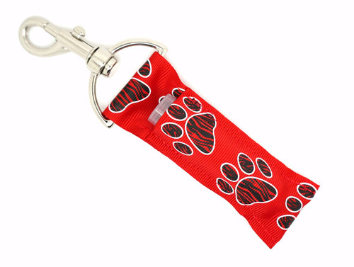 Lip Balm Holder Red with Black Zebra Paw Prints   Each Lip Balm / Chapstick Holder is HANDMADE with a high-quality material! Our unique design's and clasp offer both style and functionality. The hook is also on a swivel head so the lip balm always falls back down and never gets stuck upside down, this is where most lip balm holders lose your lip balm or chapstick! The holder is designed to snuggly fit nice and cozy any standard chapstick or lip balm. This ensures that the lip balm / chapstick won't fall out when needed most.   BENEFITS: Misplacing or Losing your chapstick is the worst!! Don't let that happen again and buy the perfect solution! Our Lip Balm / Chapstick Holder Keychain will make sure you always have your Gettin Lippy lip balm at hand when desperately needed. Our cute fun designs will compliment anything. Attach it to your keys, lanyard, back-pack, bag, purse, or anywhere your little heart desires with our easy open clasp!    PERFECT GIFTS: A simple gift can go a long way. Everyone needs something cute and functional. Buy now for stocking stuffers, birthday party, a team gift or for a daughter, friend, wife, girlfriend, colleague, student, teacher, etc!   BUY WITH CONFIDENCE: Read the reviews! Our Gettin Lippy Lip balm holders are the number one rated lip balm holders on the market! If you don't LOVE our product, we offer 100% Money Back GUARANTEE no questions asked.    PACKAGE INCLUDES:  1 Unique Lip Balm / Chapstick holder. Each Holder is 6.5 inches (with hook) x 1.5 inches. **NOTE: Gettin Lippy lip balms in pictures are not included but click on the link below and get the best multi-flavored lip balm on the market:   https://gettinlippy.com/gettin-lippyoriginal-line/     MADE IN THE USA!!