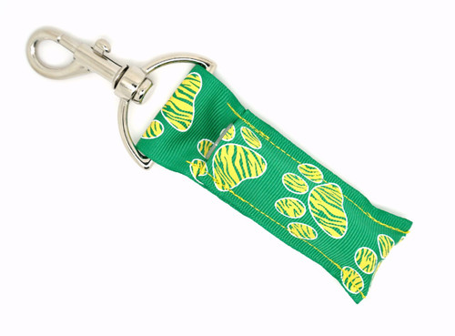 Lip Balm Holder Green with Yellow Zebra  Paw Prints   Each Lip Balm / Chapstick Holder is HANDMADE with a high-quality material! Our unique design's and clasp offer both style and functionality. The hook is also on a swivel head so the lip balm always falls back down and never gets stuck upside down, this is where most lip balm holders lose your lip balm or chapstick! The holder is designed to snuggly fit nice and cozy any standard chapstick or lip balm. This ensures that the lip balm / chapstick won't fall out when needed most.   BENEFITS: Misplacing or Losing your chapstick is the worst!! Don't let that happen again and buy the perfect solution! Our Lip Balm / Chapstick Holder Keychain will make sure you always have your Gettin Lippy lip balm at hand when desperately needed. Our cute fun designs will compliment anything. Attach it to your keys, lanyard, back-pack, bag, purse, or anywhere your little heart desires with our easy open clasp!   PERFECT GIFTS: A simple gift can go a long way. Everyone needs something cute and functional. Buy now for stocking stuffers, birthday party, a team gift or for a daughter, friend, wife, girlfriend, colleague, student, teacher, etc! Also make sure you checkout our custom lip balms!   BUY WITH CONFIDENCE: Read the reviews! Our Gettin Lippy Lip balm holders are the number one rated lip balm holders on the market! If you don't LOVE our product, we offer 100% Money Back GUARANTEE no questions asked.  PACKAGE INCLUDES:  1 Unique Lip Balm / Chapstick holder. Each Holder is 6.5 inches (with hook) x 1.5 inches. **NOTE: Gettin Lippy lip balms in pictures are not included but click on the link below and get the best multi-flavored lip balm on the market:   https://gettinlippy.com/gettin-lippyoriginal-line/     MADE IN THE USA!!
