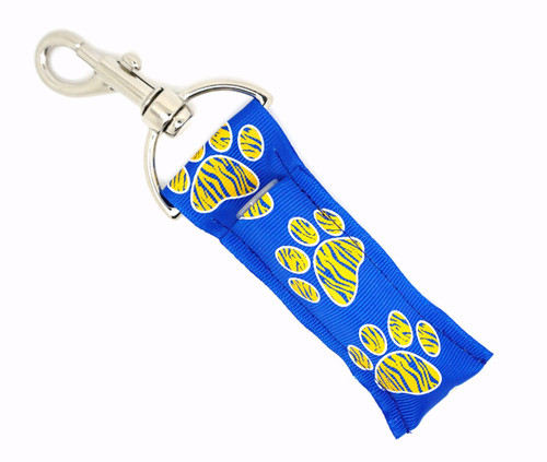 Lip Balm Holder Blue with Yellow Zebra Paw Prints  Each Lip Balm / Chapstick Holder is HANDMADE with a high-quality material! Our unique design's and clasp offer both style and functionality. The hook is also on a swivel head so the lip balm always falls back down and never gets stuck upside down, this is where most lip balm holders lose your lip balm or chapstick! The holder is designed to snuggly fit nice and cozy any standard chapstick or lip balm. This ensures that the lip balm / chapstick won't fall out when needed most.    BENEFITS: Misplacing or Losing your chapstick is the worst!! Don't let that happen again and buy the perfect solution! Our Lip Balm / Chapstick Holder Keychain will make sure you always have your Gettin Lippy lip balm at hand when desperately needed. Our cute fun designs will compliment anything. Attach it to your keys, lanyard, back-pack, bag, purse, or anywhere your little heart desires with our easy open clasp!   PERFECT GIFTS: A simple gift can go a long way. Everyone needs something cute and functional. Buy now for stocking stuffers, birthday party, a team gift or for a daughter, friend, wife, girlfriend, colleague, student, teacher, etc! Also make sure you checkout our custom lip balms!    BUY WITH CONFIDENCE: Read the reviews! Our Gettin Lippy Lip balm holders are the number one rated lip balm holders on the market! If you don't LOVE our product, we offer 100% Money Back GUARANTEE no questions asked.    PACKAGE INCLUDES:  1 Unique Lip Balm / Chapstick holder. Each Holder is 6.5 inches (with hook) x 1.5 inches. **NOTE: Gettin Lippy lip balms in pictures are not included but click on the link below and get the best multi-flavored lip balm on the market:   https://gettinlippy.com/gettin-lippyoriginal-line/       MADE IN THE USA!!
