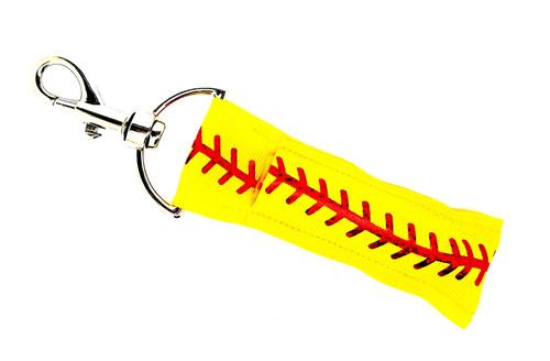 Lip Balm Holder Softball Yellow with Red Foil Laces   Each Lip Balm / Chapstick Holder is HANDMADE with a high-quality material! Our unique design's and clasp offer both style and functionality. The hook is also on a swivel head so the lip balm always falls back down and never gets stuck upside down, this is where most lip balm holders lose your lip balm or chapstick! The holder is designed to snuggly fit nice and cozy any standard chapstick or lip balm. This ensures that the lip balm / chapstick won't fall out when needed most.  BENEFITS: Misplacing or Losing your chapstick is the worst!! Don't let that happen again and buy the perfect solution! Our Lip Balm / Chapstick Holder Keychain will make sure you always have your Gettin Lippy lip balm at hand when desperately needed. Our cute fun designs will compliment anything. Attach it to your keys, lanyard, back-pack, bag, purse, or anywhere your little heart desires with our easy open clasp!   PERFECT GIFTS: A simple gift can go a long way. Everyone needs something cute and functional. Buy now for stocking stuffers, birthday party, a team gift or for a daughter, friend, wife, girlfriend, colleague, student, teacher, etc!  BUY WITH CONFIDENCE: Read the reviews! Our Gettin Lippy Lip balm holders are the number one rated lip balm holders on the market! If you don't LOVE our product, we offer 100% Money Back GUARANTEE no questions asked.  PACKAGE INCLUDES:  1 Unique Lip Balm / Chapstick holder. Each Holder is 6.5 inches (with hook) x 1.5 inches. **NOTE: Gettin Lippy lip balms in pictures are not included but click on the link below and get the best multi-flavored lip balm on the market:   https://gettinlippy.com/gettin-lippyoriginal-line/    HANDMADE IN THE USA!!