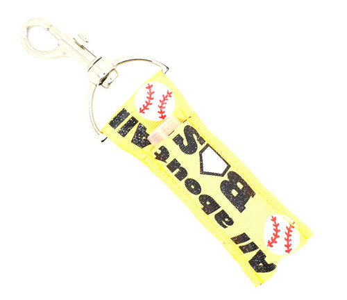 Lip Balm Holder Softball It's all about that Base Yellow with Glitter  Each Lip Balm / Chapstick Holder is HANDMADE with a high-quality material! Our unique design's and clasp offer both style and functionality. The hook is also on a swivel head so the lip balm always falls back down and never gets stuck upside down, this is where most lip balm holders lose your lip balm or chapstick! The holder is designed to snuggly fit nice and cozy any standard chapstick or lip balm. This ensures that the lip balm / chapstick won't fall out when needed most.  BENEFITS: Misplacing or Losing your chapstick is the worst!! Don't let that happen again and buy the perfect solution! Our Lip Balm / Chapstick Holder Keychain will make sure you always have your Gettin Lippy lip balm at hand when desperately needed. Our cute fun designs will compliment anything. Attach it to your keys, lanyard, back-pack, bag, purse, or anywhere your little heart desires with our easy open clasp!  PERFECT GIFTS: A simple gift can go a long way. Everyone needs something cute and functional. Buy now for stocking stuffers, birthday party, a team gift or for a daughter, friend, wife, girlfriend, colleague, student, teacher, etc!   BUY WITH CONFIDENCE: Read the reviews! Our Gettin Lippy Lip balm holders are the number one rated lip balm holders on the market! If you don't LOVE our product, we offer 100% Money Back GUARANTEE no questions asked.  PACKAGE INCLUDES:  1 Unique Lip Balm / Chapstick holder. Each Holder is 6.5 inches (with hook) x 1.5 inches. **NOTE: Gettin Lippy lip balms in pictures are not included but click on the link below and get the best multi-flavored lip balm on the market:   https://gettinlippy.com/gettin-lippyoriginal-line/    HANDMADE IN THE USA!!