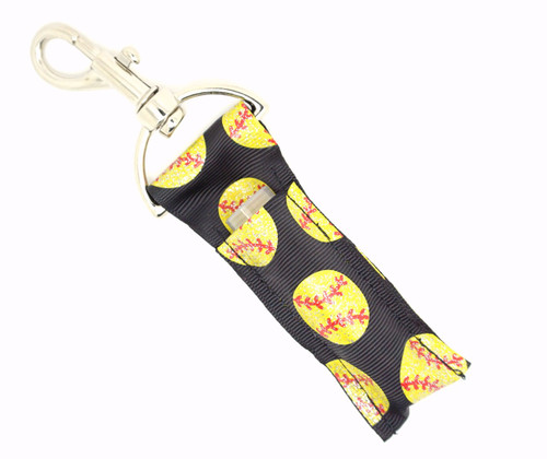 Lip Balm Holder Black with Yellow Glitter Softballs   Each Lip Balm / Chapstick Holder is HANDMADE with a high-quality material! Our unique design's and clasp offer both style and functionality. The hook is also on a swivel head so the lip balm always falls back down and never gets stuck upside down, this is where most lip balm holders lose your lip balm or chapstick! The holder is designed to snuggly fit nice and cozy any standard chapstick or lip balm. This ensures that the lip balm / chapstick won't fall out when needed most.  BENEFITS: Misplacing or Losing your chapstick is the worst!! Don't let that happen again and buy the perfect solution! Our Lip Balm / Chapstick Holder Keychain will make sure you always have your Gettin Lippy lip balm at hand when desperately needed. Our cute fun designs will compliment anything. Attach it to your keys, lanyard, back-pack, bag, purse, or anywhere your little heart desires with our easy open clasp!  PERFECT GIFTS: A simple gift can go a long way. Everyone needs something cute and functional. Buy now for stocking stuffers, birthday party, a team gift or for a daughter, friend, wife, girlfriend, colleague, student, teacher, etc!  BUY WITH CONFIDENCE: Read the reviews! Our Gettin Lippy Lip balm holders are the number one rated lip balm holders on the market! If you don't LOVE our product, we offer 100% Money Back GUARANTEE no questions asked!   PACKAGE INCLUDES:  1 Unique Lip Balm / Chapstick holder. Each Holder is 6.5 inches (with hook) x 1.5 inches. **NOTE: Gettin Lippy lip balms in pictures are not included but click on the link below and get the best multi-flavored lip balm on the market:   https://gettinlippy.com/gettin-lippyoriginal-line/    HANDMADE IN THE USA!!