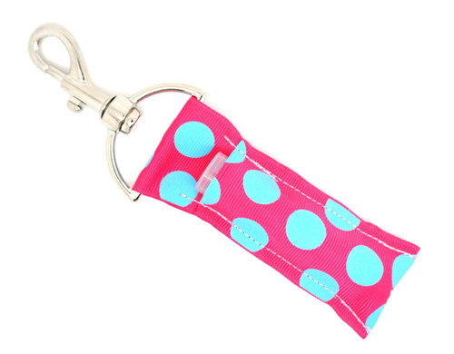 Pink with Large Light Blue Dots lip balm holder      This lip balms holder is very durable with a stainless steel hook that is easily attached and unattached to a purse, keys, backpack, or lanyard. This lip balm holder is pink and has large light blue dots.  MADE IN THE USA!!