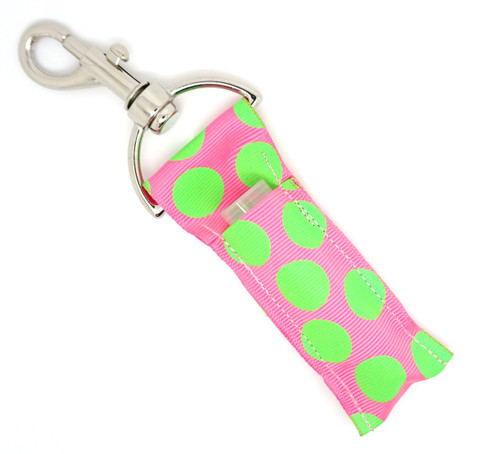 Light Pink with Large Lime Green Dots Lip Balm Holder     Each Lip Balm / Chapstick Holder is HANDMADE with a high-quality material! Our unique design's and clasp offer both style and functionality. The hook is also on a swivel head so the lip balm always falls back down and never gets stuck upside down, this is where most lip balm holders loose your lip balm or chapstick! The holder is designed to snuggly fit any standard chapstick or lip balm. This ensures that the lip balm / chapstick won't fall out when needed most.    BENEFITS: Misplacing or Losing your chapstick is the worst!! Don't let that happen again and buy the perfect solution! Our Lip Balm / Chapstick Holder Keychain will make sure you always have your Gettin Lippy lip balm at hand when desperately needed. Our cute fun designs will compliment anything. Attach it to your keys, lanyard, back-pack, bag, purse, or anywhere your little heart desires with our easy open clasp!    PERFECT GIFTS: A simple gift can go a long way. Everyone needs something cute and functional. Buy now for stocking stuffers, birthday party, a team gift or for a daughter, friend, wife, girlfriend, colleague, student, teacher, etc!    BUY WITH CONFIDENCE: Read the reviews! Our Gettin Lippy Lip balm holder's are the number one rated lip balm holder on the market! If you don't LOVE our product we offer 100% Money Back GUARANTEE no questions asked.    PACKAGE INCLUDES:  1 Unique Lip Balm / Chapstick holder. Each Holder is 6.5 inches (with hook) x 1.5 inches. **NOTE: Gettin Lippy lip balms in pictures are not included but click on the link below and get the best multi-flavored lip balm on the market:   https://gettinlippy.com/gettin-lippyoriginal-line/     HANDMADE IN THE USA!!