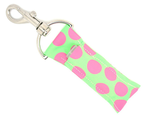Lip Balm Holder Lime Green with Large Pink Dots    Each Lip Balm / Chapstick Holder is HANDMADE with a high-quality material! Our unique design's and clasp offer both style and functionality. The hook is also on a swivel head so the lip balm always falls back down and never gets stuck upside down, this is where most lip balm holders lose your lip balm or chapstick! The holder is designed to snuggly fit nice and cozy any standard chapstick or lip balm. This ensures that the lip balm / chapstick won't fall out when needed most.  BENEFITS: Misplacing or Losing your chapstick is the worst!! Don't let that happen again and buy the perfect solution! Our Lip Balm / Chapstick Holder Keychain will make sure you always have your Gettin Lippy lip balm at hand when desperately needed. Our cute fun designs will compliment anything. Attach it to your keys, lanyard, back-pack, bag, purse, or anywhere your little heart desires with our easy open clasp!  PERFECT GIFTS: A simple gift can go a long way. Everyone needs something cute and functional. Buy now for stocking stuffers, birthday party, a team gift or for a daughter, friend, wife, girlfriend, colleague, student, teacher, etc!  BUY WITH CONFIDENCE: Read the reviews! Our Gettin Lippy Lip balm holders are the number one rated lip balm holders on the market! If you don't LOVE our product, we offer 100% Money Back GUARANTEE no questions asked.   PACKAGE INCLUDES:  1 Unique Lip Balm / Chapstick holder. Each Holder is 6.5 inches (with hook) x 1.5 inches. **NOTE: Gettin Lippy lip balms in pictures are not included but click on the link below and get the best multi-flavored lip balm on the market:   https://gettinlippy.com/gettin-lippyoriginal-line/     HANDMADE IN THE USA!!