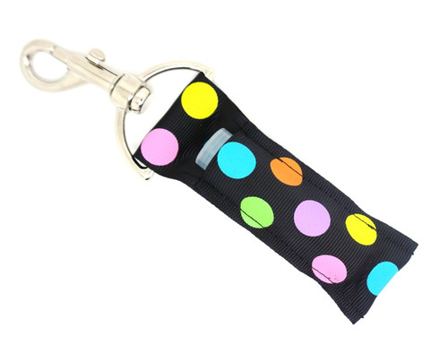Black with Bright Multi-Colored Dots Lip Balm Holder   Each Lip Balm / Chapstick Holder is HANDMADE with a high-quality material! Our unique design's and clasp offer both style and functionality. The hook is also on a swivel head so the lip balm always falls back down and never gets stuck upside down, this is where most lip balm holders loose your lip balm or chapstick! The holder is designed to snuggly fit nice and cozy any standard chapstick or lip balm. This ensures that the lip balm / chapstick won't fall out when needed most.