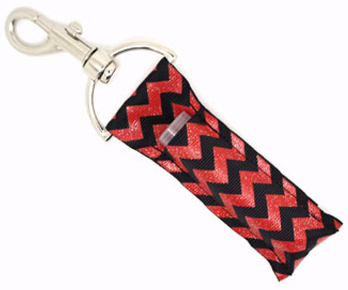 Lip Balm Holder Black and Red with Glitter Chevron   Each Lip Balm / Chapstick Holder is HANDMADE with a high-quality material! Our unique design's and clasp offer both style and functionality. The hook is also on a swivel head so the lip balm always falls back down and never gets stuck upside down, this is where most lip balm holders lose your lip balm or chapstick! The holder is designed to snuggly fit nice and cozy any standard chapstick or lip balm. This ensures that the lip balm / chapstick won't fall out when needed most.  BENEFITS: Misplacing or Losing your chapstick is the worst!! Don't let that happen again and buy the perfect solution! Our Lip Balm / Chapstick Holder Keychain will make sure you always have your Gettin Lippy lip balm at hand when desperately needed. Our cute fun designs will compliment anything. Attach it to your keys, lanyard, back-pack, bag, purse, or anywhere your little heart desires with our easy open clasp!   PERFECT GIFTS: A simple gift can go a long way. Everyone needs something cute and functional. Buy now for stocking stuffers, birthday party, a team gift or for a daughter, friend, wife, girlfriend, colleague, student, teacher, etc!  BUY WITH CONFIDENCE: Read the reviews! Our Gettin Lippy Lip balm holders are the number one rated lip balm holders on the market! If you don't LOVE our product, we offer 100% Money Back GUARANTEE no questions asked.   PACKAGE INCLUDES:  1 Unique Lip Balm / Chapstick holder. Each Holder is 6.5 inches (with hook) x 1.5 inches. **NOTE: Gettin Lippy lip balms in pictures are not included but click on the link below and get the best multi-flavored lip balm on the market:   https://gettinlippy.com/gettin-lippyoriginal-line/     HANDMADE IN THE USA!!