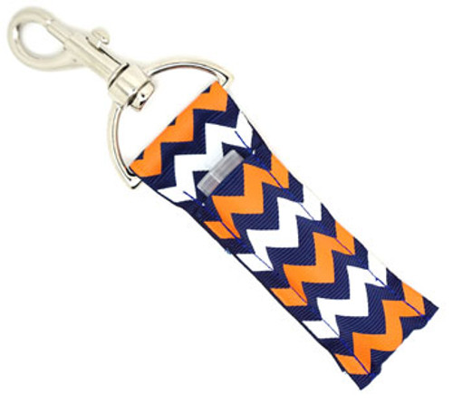 Lip Balm Holder Navy Blue Orange and White Chevron  Each Lip Balm / Chapstick Holder is HANDMADE with a high-quality material! Our unique design's and clasp offer both style and functionality. The hook is also on a swivel head so the lip balm always falls back down and never gets stuck upside down, this is where most lip balm holders lose your lip balm or chapstick! The holder is designed to snuggly fit nice and cozy any standard chapstick or lip balm. This ensures that the lip balm / chapstick won't fall out when needed most.   BENEFITS: Misplacing or Losing your chapstick is the worst!! Don't let that happen again and buy the perfect solution! Our Lip Balm / Chapstick Holder Keychain will make sure you always have your Gettin Lippy lip balm at hand when desperately needed. Our cute fun designs will compliment anything. Attach it to your keys, lanyard, back-pack, bag, purse, or anywhere your little heart desires with our easy open clasp!  PERFECT GIFTS: A simple gift can go a long way. Everyone needs something cute and functional. Buy now for stocking stuffers, birthday party, a team gift or for a daughter, friend, wife, girlfriend, colleague, student, teacher, etc!   BUY WITH CONFIDENCE: Read the reviews! Our Gettin Lippy Lip balm holders are the number one rated lip balm holders on the market! If you don't LOVE our product, we offer 100% Money Back GUARANTEE no questions asked.  PACKAGE INCLUDES:  1 Unique Lip Balm / Chapstick holder. Each Holder is 6.5 inches (with hook) x 1.5 inches. **NOTE: Gettin Lippy lip balms in pictures are not included but click on the link below and get the best multi-flavored lip balm on the market:   https://gettinlippy.com/gettin-lippyoriginal-line/     HANDMADE IN THE USA!!