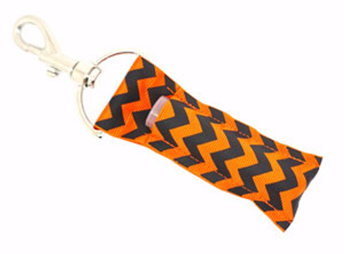 Black and Orange Chevron lip balm holder   This lip balms holder is very durable with a stainless steel hook that is easily attached and unattached to a purse, keys, backpack, or lanyard.