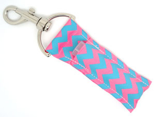 Light Blue and Pink Chevron Lip Balm Holder  Each Lip Balm / Chapstick Holder is HANDMADE with a high-quality material! Our unique design's and clasp offer both style and functionality. The hook is also on a swivel head so the lip balm always falls back down and never gets stuck upside down, this is where most lip balm holders loose your lip balm or chapstick! The holder is designed to snuggly fit any standard chapstick or lip balm. This ensures that the lip balm / chapstick won't fall out when needed most.