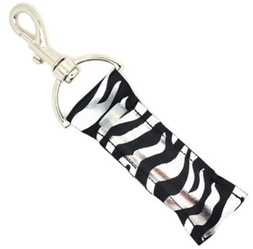 Lip Balm Holder Black with Silver Foil Zebra Print   Each Lip Balm / Chapstick Holder is HANDMADE with a high-quality material! Our unique design's and clasp offer both style and functionality. The hook is also on a swivel head so the lip balm always falls back down and never gets stuck upside down, this is where most lip balm holders loose your lip balm or chapstick! The holder is designed to snuggly fit any standard chapstick or lip balm. This ensures that the lip balm / chapstick won't fall out when needed most.    BENEFITS: Misplacing or Losing your chapstick is the worst!! Don't let that happen again and buy the perfect solution! Our Lip Balm / Chapstick Holder Keychain will make sure you always have your Gettin Lippy lip balm at hand when desperately needed. Our cute fun designs will compliment anything. Attach it to your keys, lanyard, back-pack, bag, purse, or anywhere your little heart desires with our easy open clasp!  PERFECT GIFTS: A simple gift can go a long way. Everyone needs something cute and functional. Buy now for stocking stuffers, birthday party, a team gift or for a daughter, friend, wife, girlfriend, colleague, student, teacher, etc!    BUY WITH CONFIDENCE: Read the reviews! Our Gettin Lippy Lip balm holder's are the number one rated lip balm holder on the market! If you don't LOVE our product we offer 100% Money Back GUARANTEE no questions asked.   PACKAGE INCLUDES:  1 Unique Lip Balm / Chapstick holder. Each Holder is 6.5 inches (with hook) x 1.5 inches. **NOTE: Gettin Lippy lip balms in pictures are not included but click on the link below and get the best multi-flavored lip balm on the market:   https://gettinlippy.com/gettin-lippyoriginal-line/    HANDMADE IN THE USA!!