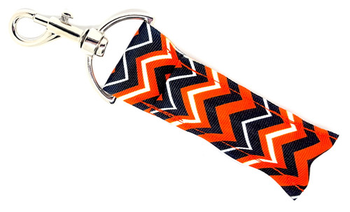Orange, Black and White Chevron lip balm holder  Each Lip Balm / Chapstick Holder is HANDMADE with a high-quality material! Our unique design's and clasp offer both style and functionality. The hook is also on a swivel head so the lip balm always falls back down and never gets stuck upside down, this is where most lip balm holders lose your lip balm or chapstick! The holder is designed to snuggly fit any standard chapstick or lip balm. This ensures that the lip balm / chapstick won't fall out when needed most.   BENEFITS: Misplacing or Losing your chapstick is the worst!! Don't let that happen again and buy the perfect solution! Our Lip Balm / Chapstick Holder Keychain will make sure you always have your Gettin Lippy lip balm at hand when desperately needed. Our cute fun designs will compliment anything. Attach it to your keys, lanyard, back-pack, bag, purse, or anywhere your little heart desires with our easy open clasp!   PERFECT GIFTS: A simple gift can go a long way. Everyone needs something cute and functional. Buy now for stocking stuffers, birthday party, a team gift or for a daughter, friend, wife, girlfriend, colleague, student, teacher, etc!   BUY WITH CONFIDENCE: Read the reviews! Our Gettin Lippy Lip balm holders are the number one rated lip balm holders on the market! If you don't LOVE our product, we offer 100% Money Back GUARANTEE no questions asked.   PACKAGE INCLUDES:  1 Unique Lip Balm / Chapstick holder. Each Holder is 6.5 inches (with hook) x 1.5 inches. **NOTE: Gettin Lippy lip balms in pictures are not included but click on the link below and get the best multi-flavored lip balm on the market:   https://gettinlippy.com/gettin-lippyoriginal-line/     HANDMADE IN THE USA!!