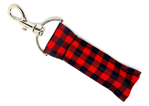 Lip Balm Holder Black and Red Buffalo Plaid  Each Lip Balm / Chapstick Holder is HANDMADE with a high-quality material! Our unique design's and clasp offer both style and functionality. The hook is also on a swivel head so the lip balm always falls back down and never gets stuck upside down, this is where most lip balm holders lose your lip balm or chapstick! The holder is designed to snuggly fit nice and cozy any standard chapstick or lip balm. This ensures that the lip balm / chapstick won't fall out when needed most.  BENEFITS: Misplacing or Losing your chapstick is the worst!! Don't let that happen again and buy the perfect solution! Our Lip Balm / Chapstick Holder Keychain will make sure you always have your Gettin Lippy lip balm at hand when desperately needed. Our cute fun designs will compliment anything. Attach it to your keys, lanyard, back-pack, bag, purse, or anywhere your little heart desires with our easy open clasp!   PERFECT GIFTS: A simple gift can go a long way. Everyone needs something cute and functional. Buy now for stocking stuffers, birthday party, a team gift or for a daughter, friend, wife, girlfriend, colleague, student, teacher, etc!  BUY WITH CONFIDENCE: Read the reviews! Our Gettin Lippy Lip balm holders are the number one rated lip balm holders on the market! If you don't LOVE our product, we offer 100% Money Back GUARANTEE no questions asked.  PACKAGE INCLUDES:  1 Unique Lip Balm / Chapstick holder. Each Holder is 6.5 inches (with hook) x 1.5 inches. **NOTE: Gettin Lippy lip balms in pictures are not included but click on the link below and get the best multi-flavored lip balm on the market:   https://gettinlippy.com/gettin-lippyoriginal-line/    HANDMADE IN THE USA!!