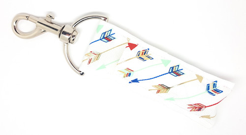 Lip Balm Holder White and Multicolored Arrows  Each Lip Balm / Chapstick Holder is HANDMADE with a high-quality material! Our unique design's and clasp offer both style and functionality. The hook is also on a swivel head so the lip balm always falls back down and never gets stuck upside down, this is where most lip balm holders lose your lip balm or chapstick! The holder is designed to snuggly fit nice and cozy any standard chapstick or lip balm. This ensures that the lip balm / chapstick won't fall out when needed most.  BENEFITS: Misplacing or Losing your chapstick is the worst!! Don't let that happen again and buy the perfect solution! Our Lip Balm / Chapstick Holder Keychain will make sure you always have your Gettin Lippy lip balm at hand when desperately needed. Our cute fun designs will compliment anything. Attach it to your keys, lanyard, back-pack, bag, purse, or anywhere your little heart desires with our easy open clasp!   PERFECT GIFTS: A simple gift can go a long way. Everyone needs something cute and functional. Buy now for stocking stuffers, birthday party, a team gift or for a daughter, friend, wife, girlfriend, colleague, student, teacher, etc!  BUY WITH CONFIDENCE: Read the reviews! Our Gettin Lippy Lip balm holders are the number one rated lip balm holders on the market! If you don't LOVE our product, we offer 100% Money Back GUARANTEE no questions asked.  PACKAGE INCLUDES:  1 Unique Lip Balm / Chapstick holder. Each Holder is 6.5 inches (with hook) x 1.5 inches. **NOTE: Gettin Lippy lip balms in pictures are not included but click on the link below and get the best multi-flavored lip balm on the market:   https://gettinlippy.com/gettin-lippyoriginal-line/    MADE IN THE USA!!