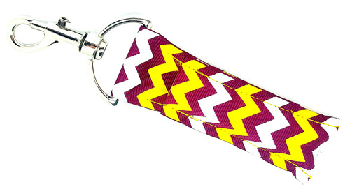 Lip balm holder Burgundy Yellow and White Chevron    Each Lip Balm / Chapstick Holder is HANDMADE with a high-quality material! Our unique design's and clasp offer both style and functionality. The hook is also on a swivel head so the lip balm always falls back down and never gets stuck upside down, this is where most lip balm holders lose your lip balm or chapstick! The holder is designed to snuggly fit nice and cozy any standard chapstick or lip balm. This ensures that the lip balm / chapstick won't fall out when needed most.     BENEFITS: Misplacing or Losing your chapstick is the worst!! Don't let that happen again and buy the perfect solution! Our Lip Balm / Chapstick Holder Keychain will make sure you always have your Gettin Lippy lip balm at hand when desperately needed. Our cute fun designs will compliment anything. Attach it to your keys, lanyard, back-pack, bag, purse, or anywhere your little heart desires with our easy open clasp!   PERFECT GIFTS: A simple gift can go a long way. Everyone needs something cute and functional. Buy now for stocking stuffers, birthday party, a team gift or for a daughter, friend, wife, girlfriend, colleague, student, teacher, etc!    BUY WITH CONFIDENCE: Read the reviews! Our Gettin Lippy Lip balm holders are the number one rated lip balm holders on the market! If you don't LOVE our product, we offer 100% Money Back GUARANTEE no questions asked.   PACKAGE INCLUDES:  1 Unique Lip Balm / Chapstick holder. Each Holder is 6.5 inches (with hook) x 1.5 inches. **NOTE: Gettin Lippy lip balms in pictures are not included but click on the link below and get the best multi-flavored lip balm on the market:   https://gettinlippy.com/gettin-lippyoriginal-line/     MADE IN THE USA!!