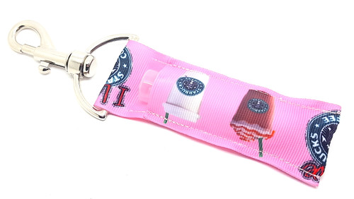Lip Balm Holder Pink I Love Starbucks    Each Lip Balm / Chapstick Holder is HANDMADE with a high-quality material! Our unique design's and clasp offer both style and functionality. The hook is also on a swivel head so the lip balm always falls back down and never gets stuck upside down, this is where most lip balm holders lose your lip balm or chapstick! The holder is designed to snuggly fit nice and cozy any standard chapstick or lip balm. This ensures that the lip balm / chapstick won't fall out when needed most.  BENEFITS: Misplacing or Losing your chapstick is the worst!! Don't let that happen again and buy the perfect solution! Our Lip Balm / Chapstick Holder Keychain will make sure you always have your Gettin Lippy lip balm at hand when desperately needed. Our cute fun designs will compliment anything. Attach it to your keys, lanyard, back-pack, bag, purse, or anywhere your little heart desires with our easy open clasp!   PERFECT GIFTS: A simple gift can go a long way. Everyone needs something cute and functional. Buy now for stocking stuffers, birthday party, a team gift or for a daughter, friend, wife, girlfriend, colleague, student, teacher, etc!  BUY WITH CONFIDENCE: Read the reviews! Our Gettin Lippy Lip balm holders are the number one rated lip balm holders on the market! If you don't LOVE our product, we offer 100% Money Back GUARANTEE no questions asked.  PACKAGE INCLUDES:  1 Unique Lip Balm / Chapstick holder. Each Holder is 6.5 inches (with hook) x 1.5 inches. **NOTE: Gettin Lippy lip balms in pictures are not included but click on the link below and get the best multi-flavored lip balm on the market:   https://gettinlippy.com/gettin-lippyoriginal-line/    MADE IN THE USA!!