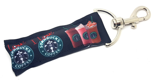 Lip Balm Holder Black I Love Starbucks    Each Lip Balm / Chapstick Holder is HANDMADE with a high-quality material! Our unique design's and clasp offer both style and functionality. The hook is also on a swivel head so the lip balm always falls back down and never gets stuck upside down, this is where most lip balm holders lose your lip balm or chapstick! The holder is designed to snuggly fit nice and cozy any standard chapstick or lip balm. This ensures that the lip balm / chapstick won't fall out when needed most.  BENEFITS: Misplacing or Losing your chapstick is the worst!! Don't let that happen again and buy the perfect solution! Our Lip Balm / Chapstick Holder Keychain will make sure you always have your Gettin Lippy lip balm at hand when desperately needed. Our cute fun designs will compliment anything. Attach it to your keys, lanyard, back-pack, bag, purse, or anywhere your little heart desires with our easy open clasp!   PERFECT GIFTS: A simple gift can go a long way. Everyone needs something cute and functional. Buy now for stocking stuffers, birthday party, a team gift or for a daughter, friend, wife, girlfriend, colleague, student, teacher, etc!  BUY WITH CONFIDENCE: Read the reviews! Our Gettin Lippy Lip balm holders are the number one rated lip balm holders on the market! If you don't LOVE our product, we offer 100% Money Back GUARANTEE no questions asked.  PACKAGE INCLUDES:  1 Unique Lip Balm / Chapstick holder. Each Holder is 6.5 inches (with hook) x 1.5 inches. **NOTE: Gettin Lippy lip balms in pictures are not included but click on the link below and get the best multi-flavored lip balm on the market:   https://gettinlippy.com/gettin-lippyoriginal-line/    MADE IN THE USA!!