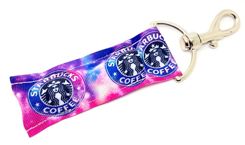 Lip Balm Holder Pink and Purple Starbucks    Each Lip Balm / Chapstick Holder is HANDMADE with a high-quality material! Our unique design's and clasp offer both style and functionality. The hook is also on a swivel head so the lip balm always falls back down and never gets stuck upside down, this is where most lip balm holders lose your lip balm or chapstick! The holder is designed to snuggly fit nice and cozy any standard chapstick or lip balm. This ensures that the lip balm / chapstick won't fall out when needed most.  BENEFITS: Misplacing or Losing your chapstick is the worst!! Don't let that happen again and buy the perfect solution! Our Lip Balm / Chapstick Holder Keychain will make sure you always have your Gettin Lippy lip balm at hand when desperately needed. Our cute fun designs will compliment anything. Attach it to your keys, lanyard, back-pack, bag, purse, or anywhere your little heart desires with our easy open clasp!  PERFECT GIFTS: A simple gift can go a long way. Everyone needs something cute and functional. Buy now for stocking stuffers, birthday party, a team gift or for a daughter, friend, wife, girlfriend, colleague, student, teacher, etc!  BUY WITH CONFIDENCE: Read the reviews! Our Gettin Lippy Lip balm holders are the number one rated lip balm holders on the market! If you don't LOVE our product, we offer 100% Money Back GUARANTEE no questions asked.  PACKAGE INCLUDES:  1 Unique Lip Balm / Chapstick holder. Each Holder is 6.5 inches (with hook) x 1.5 inches. **NOTE: Gettin Lippy lip balms in pictures are not included but click on the link below and get the best multi-flavored lip balm on the market:   https://gettinlippy.com/gettin-lippyoriginal-line/    MADE IN THE USA!!