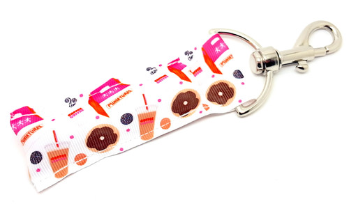 Lip Balm Holder Dunkin' Donuts    Each Lip Balm / Chapstick Holder is HANDMADE with a high-quality material! Our unique design's and clasp offer both style and functionality. The hook is also on a swivel head so the lip balm always falls back down and never gets stuck upside down, this is where most lip balm holders lose your lip balm or chapstick! The holder is designed to snuggly fit nice and cozy any standard chapstick or lip balm. This ensures that the lip balm / chapstick won't fall out when needed most.  BENEFITS: Misplacing or Losing your chapstick is the worst!! Don't let that happen again and buy the perfect solution! Our Lip Balm / Chapstick Holder Keychain will make sure you always have your Gettin Lippy lip balm at hand when desperately needed. Our cute fun designs will compliment anything. Attach it to your keys, lanyard, back-pack, bag, purse, or anywhere your little heart desires with our easy open clasp!  PERFECT GIFTS: A simple gift can go a long way. Everyone needs something cute and functional. Buy now for stocking stuffers, birthday party, a team gift or for a daughter, friend, wife, girlfriend, colleague, student, teacher, etc!   BUY WITH CONFIDENCE: Read the reviews! Our Gettin Lippy Lip balm holders are the number one rated lip balm holders on the market! If you don't LOVE our product, we offer 100% Money Back GUARANTEE no questions asked.  PACKAGE INCLUDES:  1 Unique Lip Balm / Chapstick holder. Each Holder is 6.5 inches (with hook) x 1.5 inches. **NOTE: Gettin Lippy lip balms in pictures are not included but click on the link below and get the best multi-flavored lip balm on the market:   https://gettinlippy.com/gettin-lippyoriginal-line/    MADE IN THE USA!!