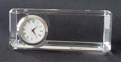 This desktop clock with quality Quartz movement is a popular gift with companies when etched with a logo.  A photo can also be added.