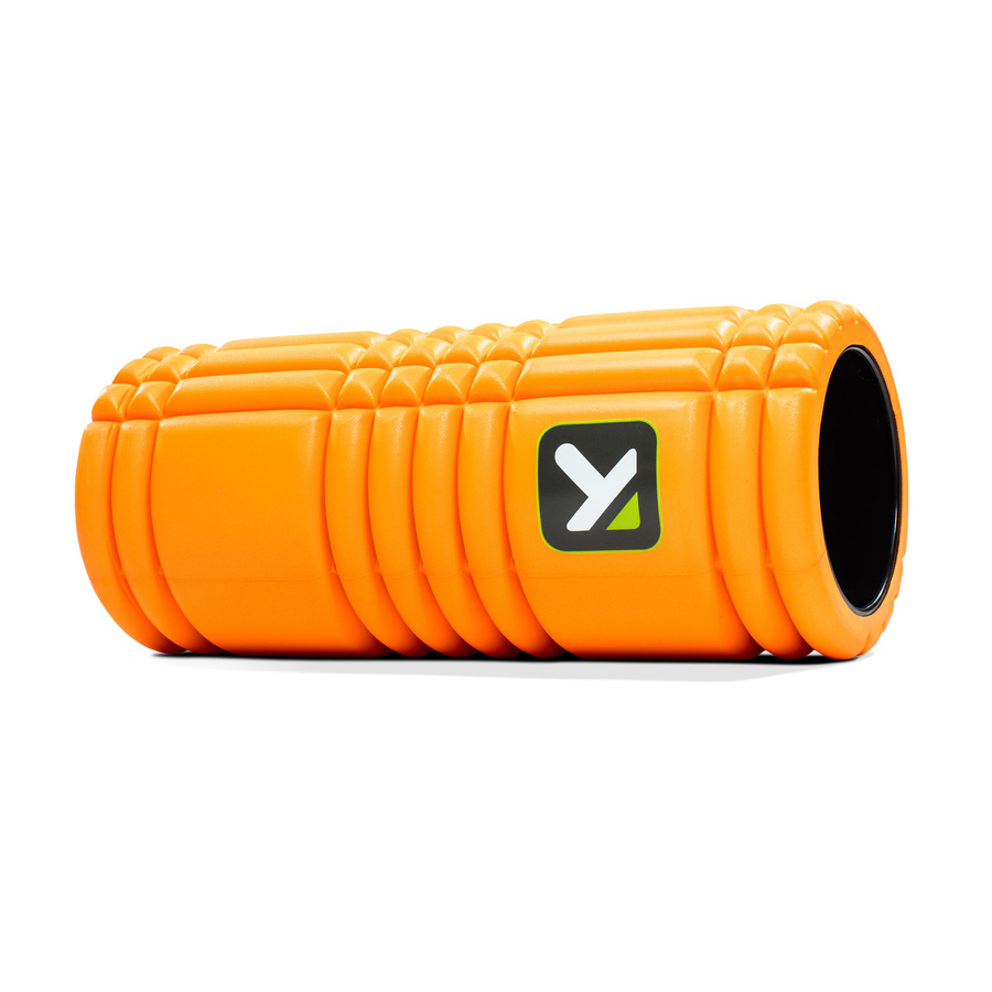 GRID Foam Roller Orange sitting horizontally on white background.