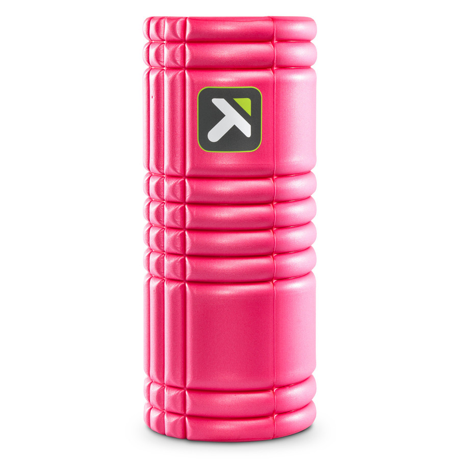 GRID Foam Roller Pink standing vertically on a white background.