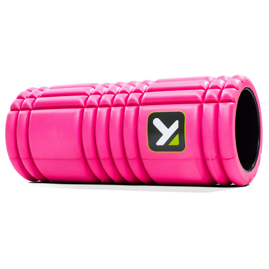 GRID Foam Roller Pink sitting horizontally on a white background.