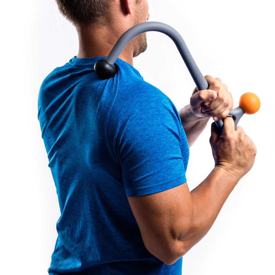 Man using Acucurve Cane on upper shoulder.