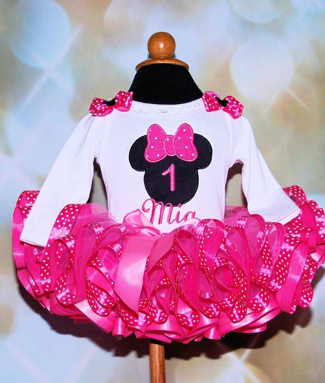 minnie mouse 1st birthday outfit with shocking pink polka dot ribbon trimmed tutu