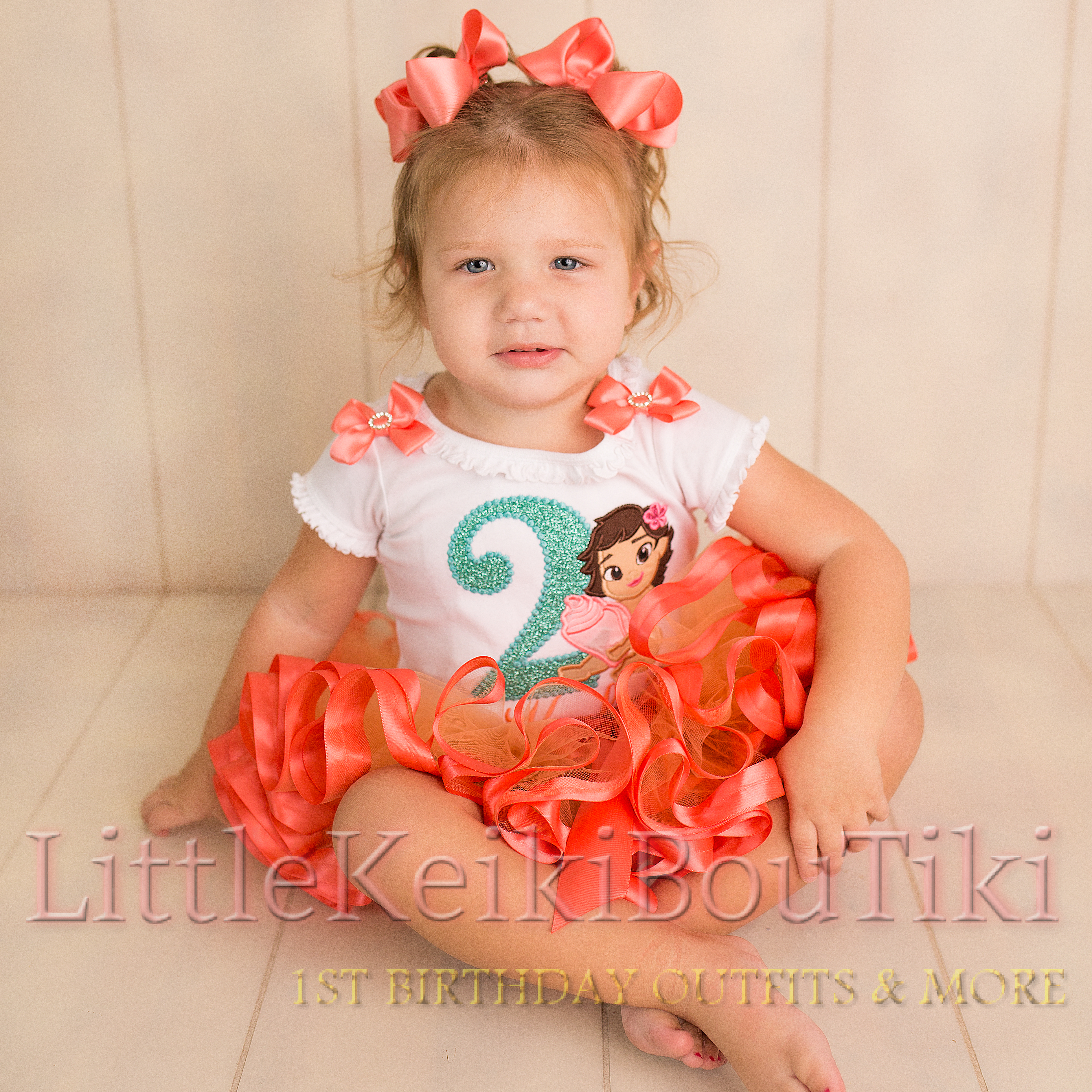 this is an image of a toddler wearing a 2nd birthday outfit girl featuring Moana. This baby dress with tutu is made as a birthday 2 piece outfit in bright coral. The ribbon trimmed tutu is full and fluffy