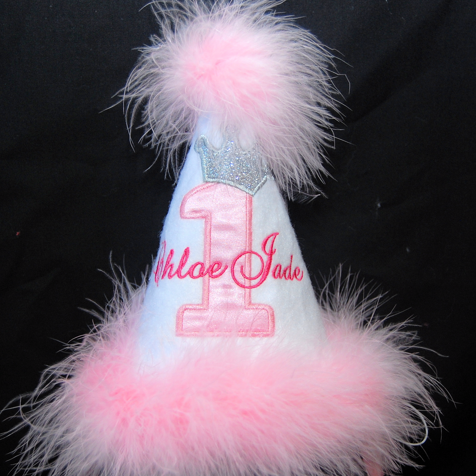 party hat trimmed with pink feathers