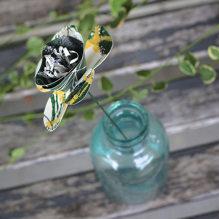GREEN AND WHITE BOBCAT PAPER FLOWER