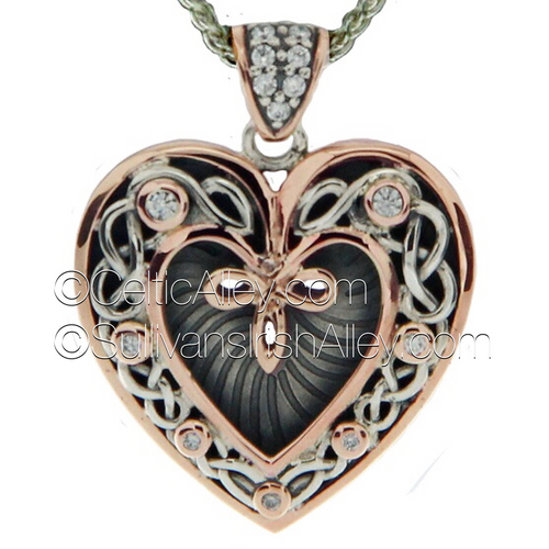 "Introducing new Keith Jack Heart pendants for Valentine's Day!  This is one of Keith Jack's new Sterling Silver with 10k rose gold White Sapphire stone set heart pendants. This comes on an  18 "" chain  Longer ines are available   PPX9164-3-WS"