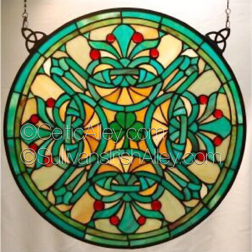 "An intricate Celtic design cradles a lone green shamrock in this splendid window. Window is large, measuring 18"" in diameter."