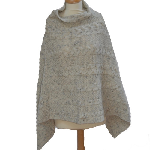 This comfortable and easy to wear poncho with traditional stitching is made from 100% wool. Made in Ireland.  Colors available: Charcoal, Green, Natural, Oatmeal, Summer Haze One Size
