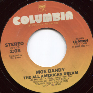 Moe Bandy: She's Not Really Cheatin' (She's Just Gettin' Even) / The All American Dream - 45 rpm Vinyl Record