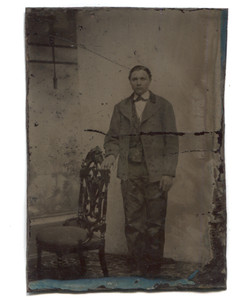 Antique 1/6 Plate Tintype Photograph of Man in Suit Standing Beside Ornate Chair