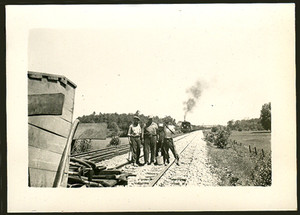 1949 Snapshot Photo of Railroad Workers on Tracks With Approaching Train