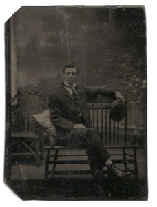 Antique 1/6th Plate Tintype Photograph of Man Reclining on Wood Bench Holding Hat
