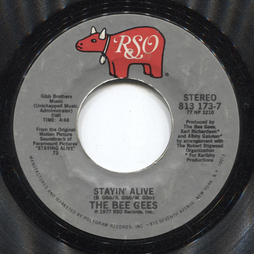 The Bee Gees: Stayin' Alive / The Woman in You - 45 rpm Vinyl Record