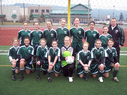 Girls soccer team in Code Four Athletics Winchester soccer jerseys and soccer shorts..