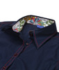 Navy Blue stretch with Liberty of London floral contrast inside the collar and cuffs. All seams are done to perfection with contrast stitching. 69% Cotton, 27% Polyamide, 4% Elastane