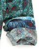 Liberty of London peacock feather print with exquisite details in shades of Teal. A reverse color of royal and magenta inside the collar stand and cuffs. Finished to perfection with a Teal crushed velvet trim inside the collar stand. 100% Cotton